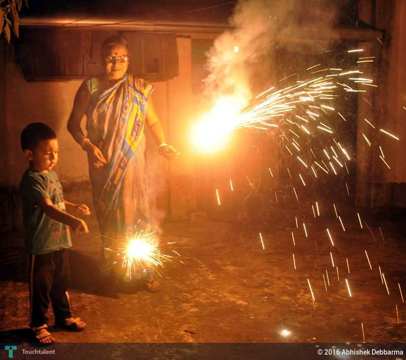 A Kid Playing With Firecrackers With His Grandmother At