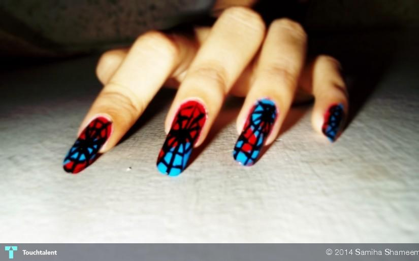 Polish off your costume with halloween inspired nail art be the super hero of the party this year rocking a classic spiderman design on your nails prinsesfo Choice Image