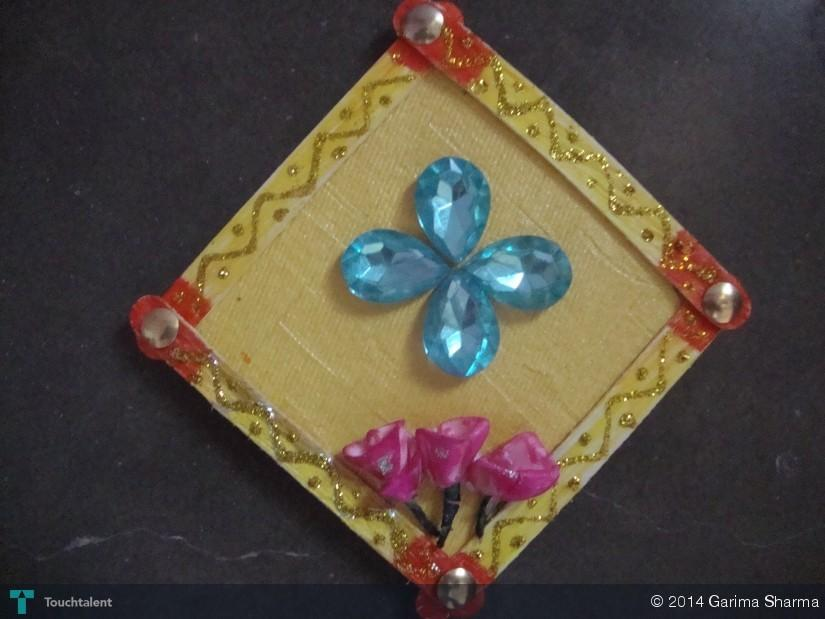 Wall hanging from waste material crafts garima sharma for Homemade items from waste materials